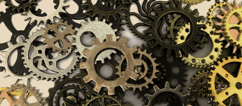 Gears turning inside a computer to symbolize technical SEO elements such as server response, DNS speed, and site structure.